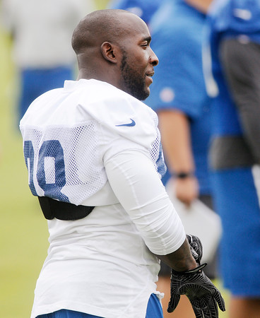 Don Knight | The Herald Bulletin<br /> Outside line backer Robert Mathis waits for practice to start during Colts Camp at Anderson University on Thursday.