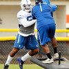 John P. Cleary | The Herald Bulletin<br /> Colts rookie OLB Trevor Bates lifts up the sled as he goes through drills Sunday at Colts Camp.