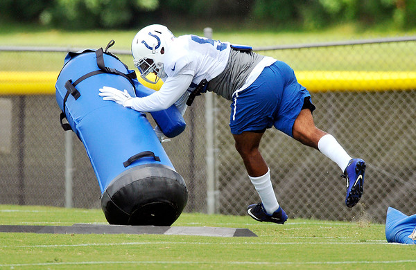 John P. Cleary   The Herald Bulletin<br /> Colts rookie OLB Trevor Bates works over the tackling dummy during drills Sunday.