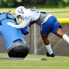 John P. Cleary | The Herald Bulletin<br /> Colts rookie OLB Trevor Bates works over the tackling dummy during drills Sunday.