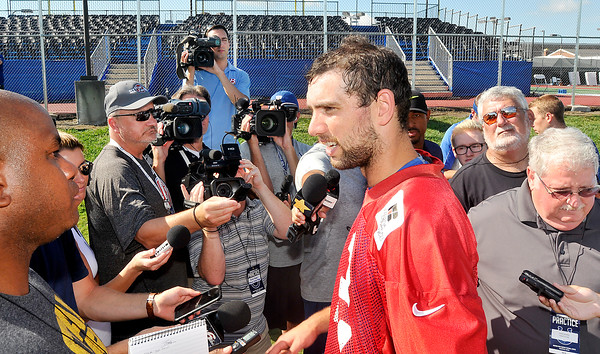 John P. Cleary | The Herald Bulletin<br /> Colts QB Andrew Luck talks with the media Thursday as training camp ended Thursday after their morning practice