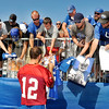 John P. Cleary | The Herald Bulletin<br /> Colts fans lean over to get their items signed by Colts QB Andrew Luck at the conclusion of Thursday mornings practice that ended training camp at AU for this year.