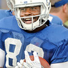 John P. Cleary | The Herald Bulletin<br /> Colts TE Dwayne Allen smiles back at the coach as he goes through ball handling drills Monday at Colts Camp.
