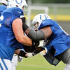 John P. Cleary | The Herald Bulletin<br /> Colts offensive lineman Hugh Thornton, right, runs through blocking drills Monday at Colts Camp.