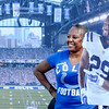 Don Knight | The Herald Bulletin<br /> Vanessa Geise of Connersville poses for a photo with a cutout of safety Mike Adams during Colts Camp at Anderson University on Tuesday.