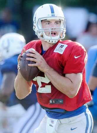 Don Knight | The Herald Bulletin<br /> Quarterback Andrew Luck looks to pass during Colts Camp at Anderson University on Tuesday.