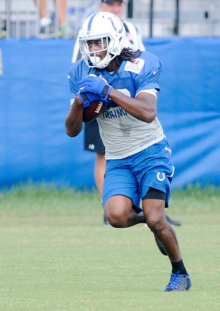 Don Knight | The Herald Bulletin<br /> Wide receiver T.Y. Hilton runs after making a catch during Colts Camp practice at Anderson University on Friday.