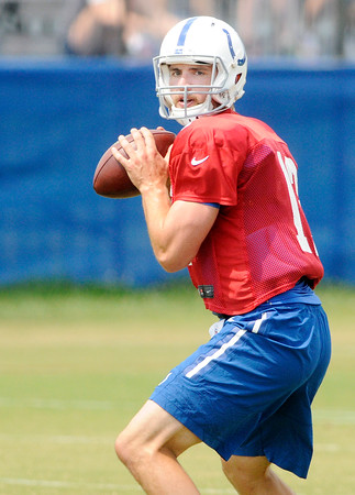 Don Knight   The Herald Bulletin<br /> Quarterback Andrew Luck drops back to pass during Colts Camp practice at Anderson University on Tuesday.