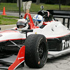 John P. Cleary | The Herald Bulletin<br /> Colts wide receiver Reggie Wayne arrived to the Colts Training Camp Wednesday in a IndyCar two-seater driven by race car driver Ed Carpenter.