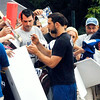 John P. Cleary | The Herald Bulletin<br /> Colts quarterback Andrew Luck signed a few autographs for fans who showed up to AU to watch the players arrive for training camp.