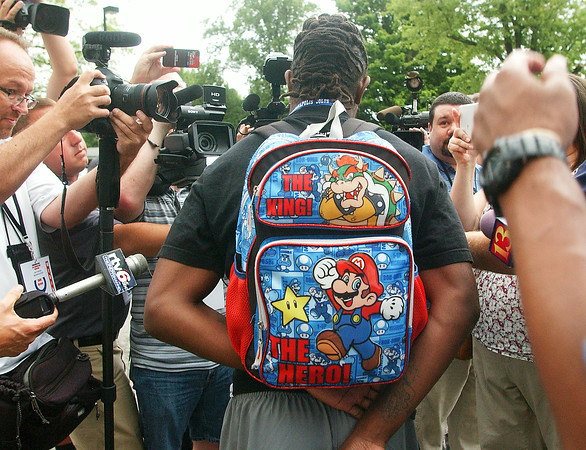 John P. Cleary | The Herald Bulletin<br /> Colts player T.Y. Hilton talks to the media after arriving to training camp Wednesday morning wearing this backback.