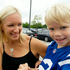 John P. Cleary | The Herald Bulletin<br /> Heather Carpenter, wife of Ed Carpenter, holds their son Ryder while waiting for her husband after he drove Reggie Wayne to training camp in a IndyCar two-seater race car.
