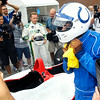 John P. Cleary | The Herald Bulletin<br /> Colts wide receiver Reggie Wayne has trouble getting his racing helmet off after he arrived to the Colts Training Camp Wednesday in a IndyCar two-seater driven by race car driver Ed Carpenter.