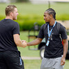 John P. Cleary | The Herald Bulletin<br /> Colts punter Pat McAfee greets wide receiver T.Y. Hilton Wednesday morning as players arrived at AU for training camp.