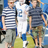 Don Knight | The Herald Bulletin<br /> From left, Micky Morrell and Mickey Morrell Jr. pose for a photo with a cutout of Andrew Luck during the Colts' only night practice in Macholtz Stadium at AU on Thursday.