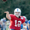 Don Knight | The Herald Bulletin<br /> Quarterback Andrew Luck makes a pass during the Colts' only night practice in Macholtz Stadium at AU on Thursday.