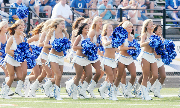 Don Knight | The Herald Bulletin<br /> The Colts cheerleaders take the field to perform before the start of the Colts' only night practice in Macholtz Stadium at AU on Thursday.
