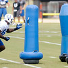 Don Knight | The Herald Bulletin<br /> Tight end Erik Swoope swats at a tackling dummy during Colts practice at AU on Friday.