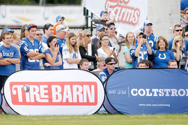 Don Knight/The Herald Bulletin<br /> Fans watch the Colts as they held their first public practice during Colts Camp on Sunday at Anderson University.