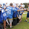 Don Knight/The Herald Bulletin<br /> Colts quarterback Andrew Luck signs autographs after practice at Anderson University on Sunday.