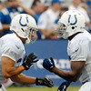Colts running backs Donald Brown, left, and Vick Ballard, right, go against one another in drills Tuesday.