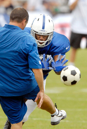 Colts linebacker Monte Simmons dives after a volleyball  during drills Tuesday simulating blocking punts.