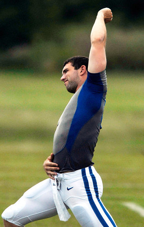 Colts quarterback Andrew Luck stretches out before the start of practice Tuesday afternoon.
