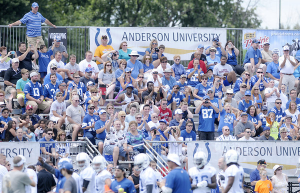 Don Knight | The Herald Bulletin<br /> Fans applaud as the Cots run onto the practice field for the first day of practice at Colts Camp on Thursday.