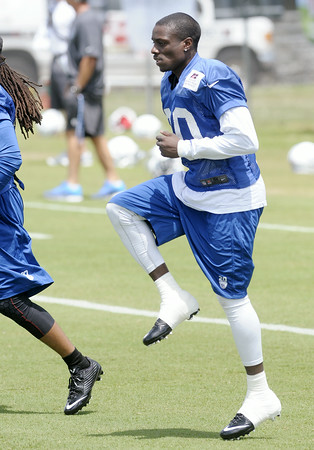 Don Knight | The Herald Bulletin<br /> Cornerback Darius Butler warms up before the first day of practice at Colts Camp on Thursday.