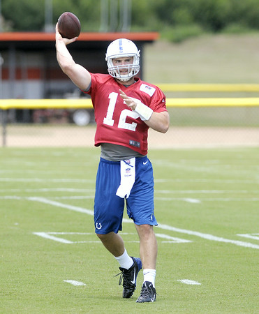 Don Knight | The Herald Bulletin<br /> Quarterback Andrew Luck passes the ball during drills on the first day of practice at Colts Camp on Thursday.
