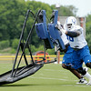 Don Knight | The Herald Bulletin<br /> From left, tackle Xavier Nixon and guard Donald Thomas push a sled during Colts Camp practice Friday at AU.
