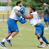 Don Knight | The Herald Bulletin<br /> From left guards Josh Walker and Hugh Thornton run through drills during Colts Camp practice Friday at AU.