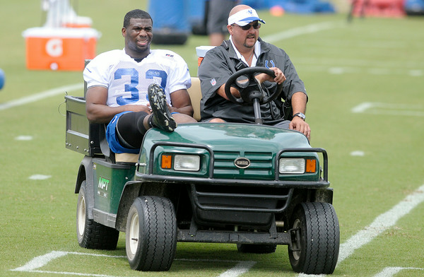 Don Knight | The Herald Bulletin<br /> Running back Vick Ballard is driven off the field during Colts Camp practice Friday at AU.