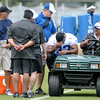 Don Knight | The Herald Bulletin<br /> Running back Vick Ballard sits in a golf cart after being helped off the field during Colts Camp practice Friday at AU.