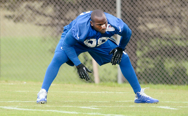 Don Knight | The Herald Bulletin<br /> Outside line backer Robert Mathis stretches before the start of practice at Colts Camp Friday at AU.