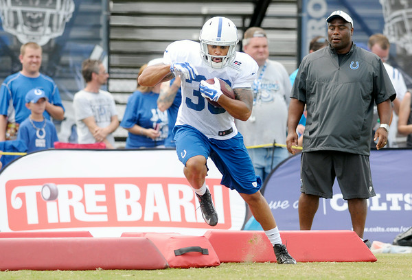 Don Knight | The Herald Bulletin<br /> Running back Daniel Herron steps over foam blocks during a drill at Colts Camp at on Saturday.