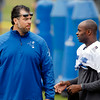 John P. Cleary | The Herald Bulletin<br /> Colts GM talks with Reggie Wayne on the sidelines.