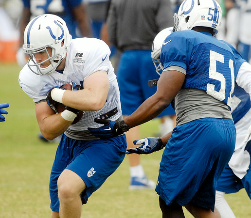 John P. Cleary | The Herald Bulletin<br /> Colts hold morning public practice.  Tight end Jack Doyle runs with the ball.