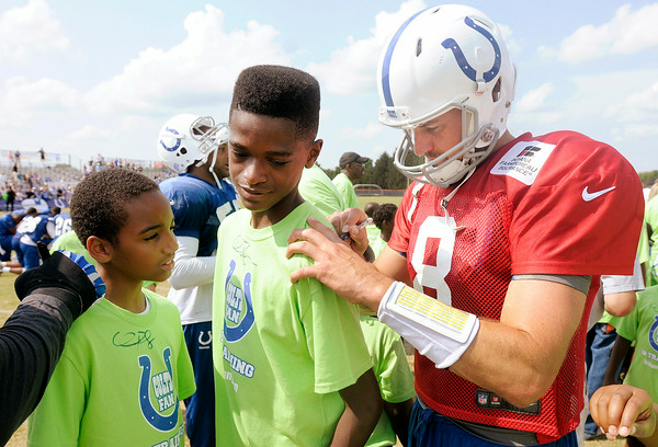 Don Knight | The Herald Bulletin<br /> Quarterback Matt Hasselbeck autographs a young fans shirt following practice at Colts Camp Wednesday at AU. A group of 23 boys from Young Men Inc. youth ministry from The Great Commission Church of God in Indianapolis were Huntington Heroes for the day and they joined the Colts in the huddle at the end of practice and had their shirts autographed by several players.