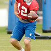 Don Knight | The Herald Bulletin<br /> Quarterback Andrew Luck hands off the ball during a drill at Colts Camp on Wednesday.