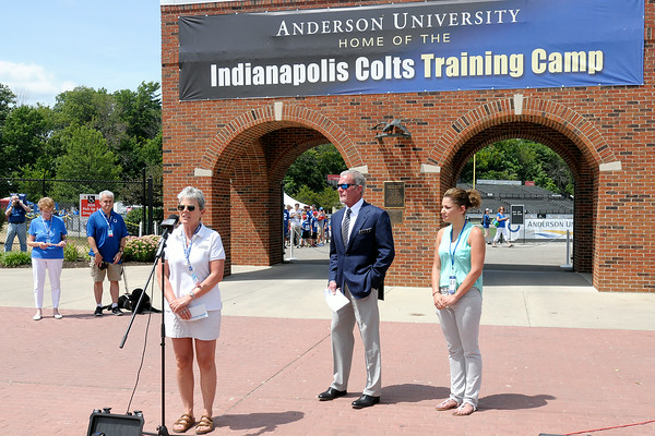 Don Knight | The Herald Bulletin<br /> Paramount Theatre Executive Director Gayle Burris speaks after accepting a $10,000 check from Colts owner Jim Irsay at Colts Camp on Sunday. Irsay donated a total of $50,000 dollars to five charities.