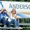 Don Knight | The Herald Bulletin<br /> A fan uses binoculars to watch the Colts practice during Colts Camp at AU on Wednesday.