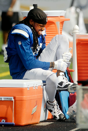 John P. Cleary | The Herald Bulletin<br /> Greg Toler tries to stretch out his leg after after coming up lame after running a play during  Saturday mornings practice.  Toler got taped up and was back out on the field.