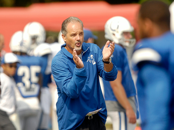 John P. Cleary | The Herald Bulletin<br /> Colts head coach Chuck Pagano cheers his players on during practice Saturday.