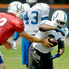 John P. Cleary   The Herald Bulletin<br /> Colts running back Trent Richardson takes the handoff from quarterback Andrew Luck during Monday's practice.