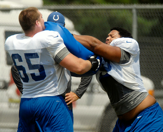 John P. Cleary | The Herald Bulletin<br /> Offensive linemen  go through drills against each other.