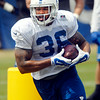 John P. Cleary | The Herald Bulletin<br /> Colts running back Daniel Herron goes through running drills during practice Monday.
