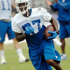 John P. Cleary | The Herald Bulletin<br /> Colts wide receiver Reggie Wayne runs up field after catching the pass.
