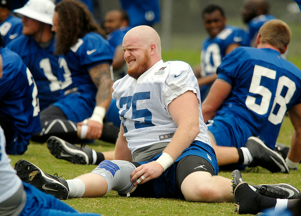 John P. Cleary | The Herald Bulletin<br /> Rookie Jack Mewhort has the one-eyed stretch down during warm-ups.