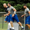 John P. Cleary | The Herald Bulletin<br /> The Colts quarterback trio warm up before practice.